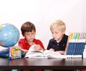 Canva Two Boys Studying a Book 300x250