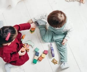 Canva Two Children Sitting Down Playing With Lego Blocks 300x250