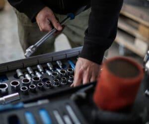 Canva Crop mechanic choosing metal tools for repair in garage 300x250